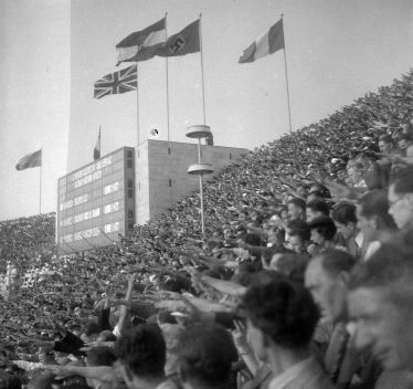 Nazi Salute during the 1936 Olympics. Image via Wikipedia.